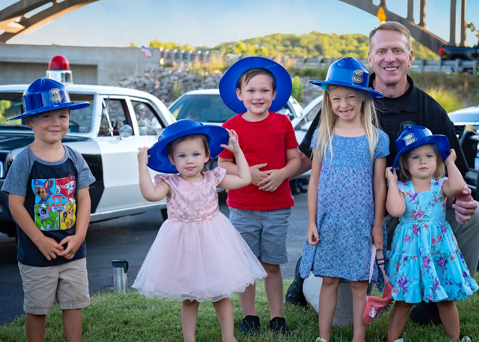 kids with classic police cars