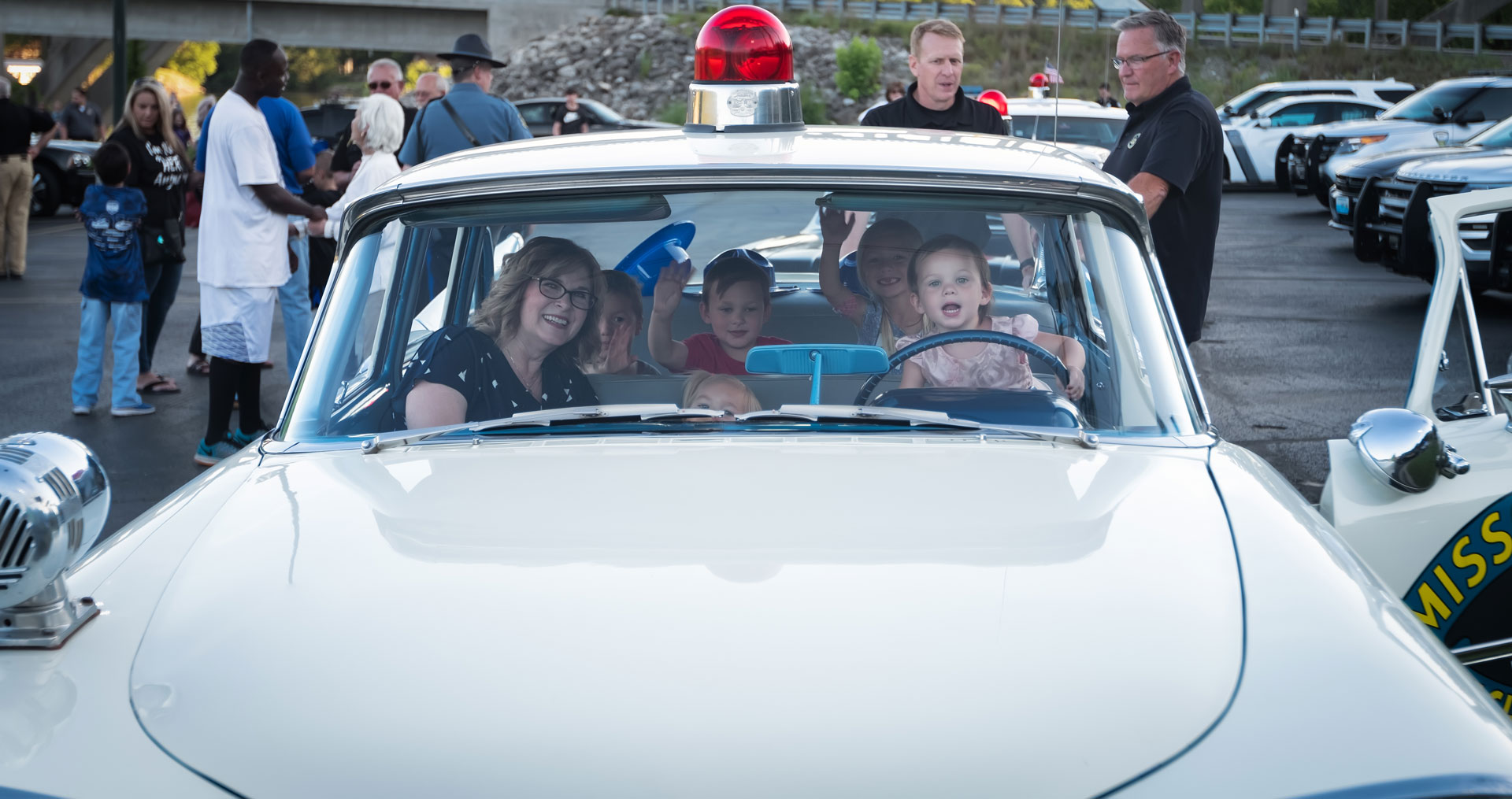kids in classic police car